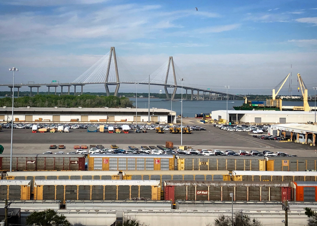 A view of the Ravenel Bridge and the Columbus Street Terminal of the Port of Charleston, taken from the rooftop of The Cigar Factory in Charleston, SC