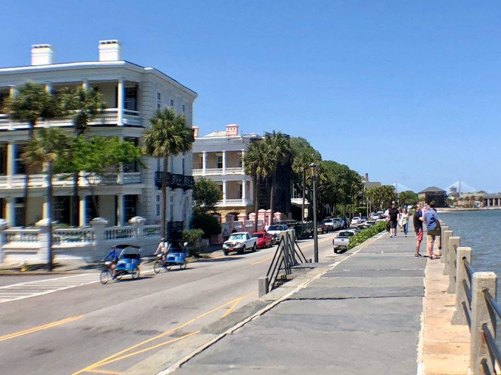 A photograph of Charleston in 2019 showing pedestrians walking along the High Battery