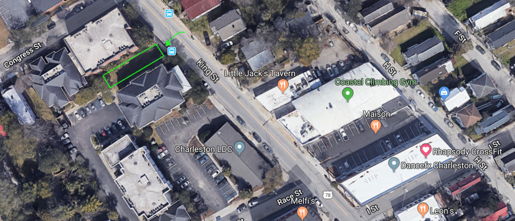 An aerial map of the 700 block of King Street in Charleston, SC marking local businesses at the site of a proposed building at 725 King Street.