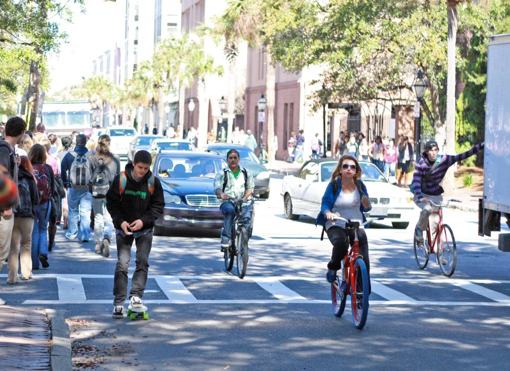 College of Charleston students riding bicycles to class