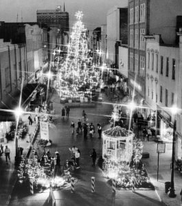 A nighttime view of King Street in 1988, showing a Christmas Tree and other holiday setups in the street